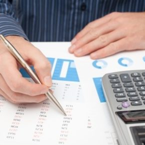 18224605 - business analysis - calculator, sheet, graph,  business report  and analyst